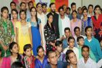 HRM in a group photograph with the students, who cleared XII with high marks and got admission to reputed colleges